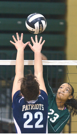 WARREN DILLAWAY / Star Beacon<br /> AALIYAH HUNT (23)  of Lakeside leaps for the spike  as Alexandrea Ballash of Valley Forge defends on Saturday during the Lakeside Volleyball Tournament.
