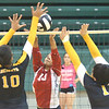 WARREN DILLAWAY / Star Beacon<br /> ASHTON NOCE (10) of  Edgewood tries to direct the ball by Alex Harper (10) and Cleveland Heights teammate Vanesa Slaughter on Saturday at Lakeide.