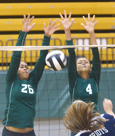 WARREN DILLAWAY / Star Beacon<br /> AALIYAH ALLGOOD (26) and Sharisse Hunt (4) leaps for a block of a spike by a Valley Forge player on Saturday during the Lakeside Volleyball Tournament.