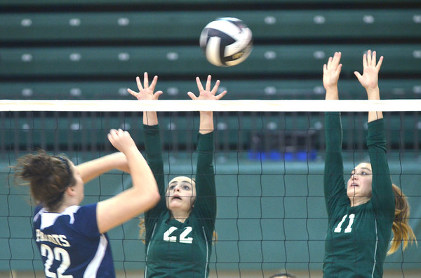 WARREN DILLAWAY / Star Beacon<br /> LEXI DAVID (22) and Alissa Patterson (11), both of Lakeside leap for a block of a spike by Alexandrea Ballash of Valley Forge on Saturday during the Lakeside Volleyball Tournament.