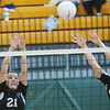 WARREN DILLAWAY /Star Beacon<br /> TAYLER JOHNSTON (21) and Jefferson teammate Hayley Allen leap for a block Saturday at the Lakeside Volleyball Invitational.