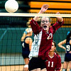 WARREN DILLAWAY / Star Beacon<br /> ALYSSA JOHNSON of Edgewood reacts to a spike while leaping for the block Saturday at the Lakeside Volleyball Invitational.