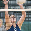 WARREN DILLAWAY / Star Beacon<br /> MACKENZIE STENROOS of St. John High School leaps for a block Saturday during the Lakeside Volleyball Invitational.
