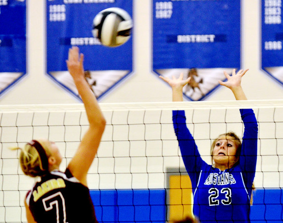 WARREN DILLAWAY / Star Beacon<br /> HOLLY NYE (23) of Grand Valley leaps for a block of a spike by Megan Stech of Pymatuning Valley on Monday evening in Orwell.