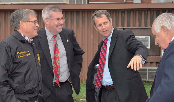 WARREN DILLAWAY / Star Beacon<br /> U.S. SENATOR Sherrod Brown talks with former Ashtabula Township Trustee Joe Pete (right) as former Congressman Dennis Eckart (far left) and Brown's Chief of Staff John Ryan during a visit to Plant C in Ashtabula Township on Monday. Connie Schultz, Brown's wife grew up in Ashtabula and her father worked in the plant for more than 30 years.