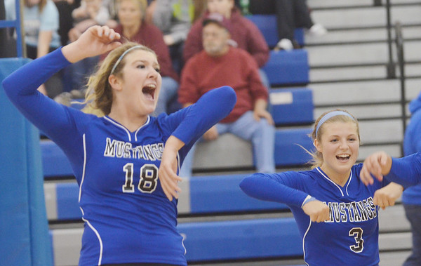 WARREN DILLAWAY / Star Beacon<br /> THOMMIE JACKSON (18) and Grand Valley teammate Abby  Paskey celebrate after a point on Monday evening during a home match with Pymatuning Valley.