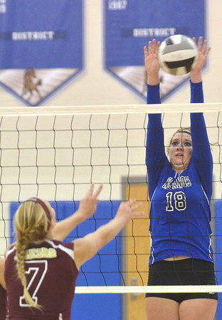 WARREN DILLAWAY / Star Beacon<br /> THOMMIE JACKSON (18) of Grand Valley leaps for a block of a spike by Megan Stech of Pymatuning Valley on Monday evening in Orwell.