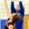 WARREN DILLAWAY / Star Beacon<br /> THOMMIE JACKSON (18) of Grand Valley leaps for a block of a spike by Abby Pfrenger of Pymatuning Valley on Monday evening in Orwell.