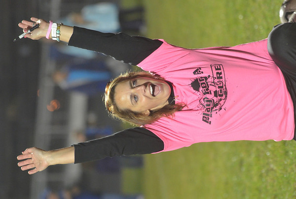 WARREN DILLAWAY / Star Beacon<br /> HOLLY HILL, the Grand Valley soccer coach, celebrates after a pee-wee soccer player scored a goal against one of her players during a post game kick-a-thon to raise money to fight cancer and diabetes.