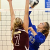WARREN DILLAWAY / Star Beacon<br /> HOLLY NYE (23) of Grand Valley leaps for a spike as  Megan Stech of Pymatuning Valley leaps for a block on Monday evening in Orwell.