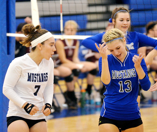 WARREN DILLAWAY / Star Beacon<br /> CALLIE FORREST (7) and Grand Valley teammate Mallarie Fernandez celebrate after a point on Monday during a home match with Pymatuning Valley.