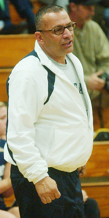 WARREN DILLAWAY / Star Beacon<br /> PAUL STOFAN, Conneaut volleyball coach, instructs his team during a home match with Edgewood Monday evening.