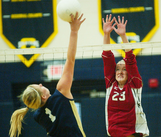 WARREN DILLAWAY / Star Beacon<br /> ALYSSA JOHNSON (23) of Edgewood leaps for a block of a spike by Conneaut's Shae BrinK Monday evening at Conneaut's Garcia Gymnasium.