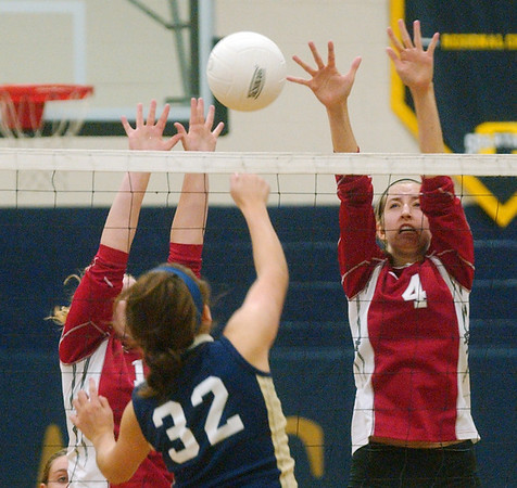 WARREN DILLAWAY / Star Beacon<br /> KATIE THOMAS (4) of Edgewood leaps for the block of a spike by Conneaut's Megan Tessmer Monday evening at Conneaut's Garcia Gymnasium.