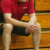 WARREN DILLAWAY / Star Beacon<br /> DAVE FOWLER, Edgewood volleyball coach, intently watches the action Monday evening during a match at Conneaut.