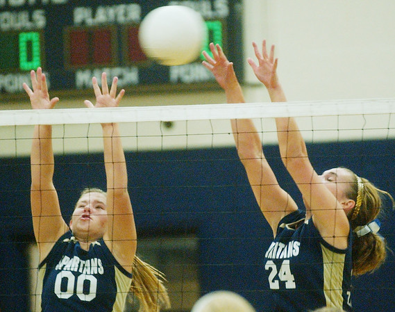 WARREN DILLAWAY / Star Beacon<br /> TORI SIMEK (00) and Conneaut teammate Angie Zappitelli leap for a block Monday evening during a home match with Edgewood.