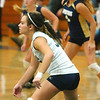 WARREN DILLAWAY / Star Beacon<br /> LYDIA COCCITTO (in white) prepares to set for Conneaut Monday evening during a home match with Edgewood.