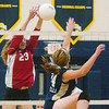 WARREN DILLAWAY / Star Beacon<br /> ALLYSSA JOHNSON (23) of Edgewood blocks a hit by Angie Zappitelli Monday evening at Garcia Gymnasium.