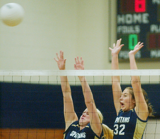 WARREN DILLAWAY / Star Beacon TORI SIMEK (left) and Conneaut teammate Megan Tessmer (32) leap for a block Monday evening during a home match with Edgewood.