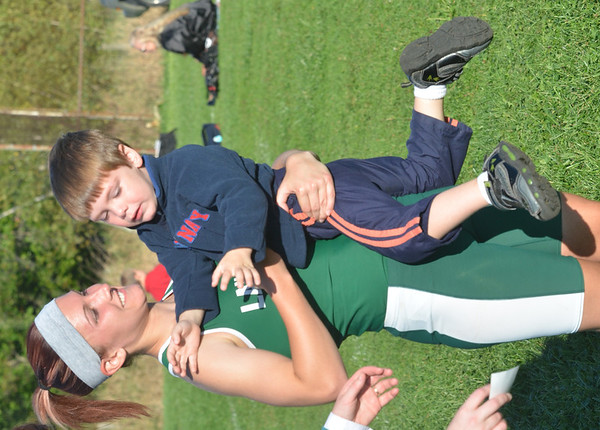 WARREN DILLAWAY / Star Beacon<br /> VICTORIA COX of Lakeside plays with her nephew Robert Jones after the Ashtabula County Cross Country Meet on Tuesday at Edgewood.