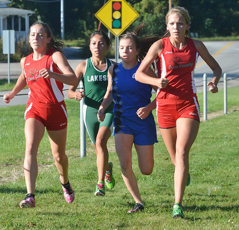 WARREN DILLAWAY / Star Beacon<br /> THE FRONT pack of the Ashtabula County Girls Cross Country Meet includes (from left) Emily Deering of Geneva; karen Barrientos of Lakeside, Jessica Finley of Grand Valley and Hailey Van Hoy of Geneva on Tuesday at Edgewood.