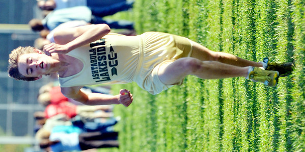 WARREN DILLAWAY / Star Beacon<br /> JOSH HOTZ of Lakeside sprints to the finish line at the Ashtabula County Cross Country Meet on Tuesday at Edgewood.