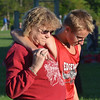 WARREN DILLAWAY / Star Beacon<br /> RYDER SIMMONS of Edgewood receives assistance from his grandmother Linnell Lilac following the Ashtabula County Cross Country Meet at Edgewood.