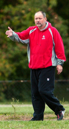 WARREN DILLAWAY / Star Beacon<br /> BRIAN O'DELL, Geneva girls soccer coach, instructs his team Tuesday during a game at Edgewood.