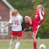 WARREN DILLAWAY / Star Beacon<br /> CASSIDY PRISTOV (17) of Geneva and Cortney Styzej of Edgewood battle for the ball Tuesday afternoon during a match at Edgewood.