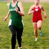 WARREN DILLAWAY / Star Beacon<br /> KRISTEN BERUS of Lakeside sprints to the finish line with Geneva's Emily Deering close behind Wednesday during the Ashtabula County Cross Country Meet at Lakeshore Park in Ashtabula Township.