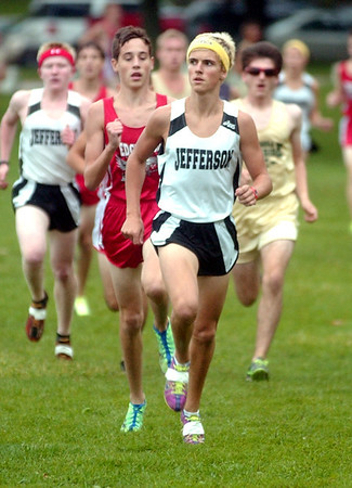 WARREN DILLAWAY / Star Beacon<br /> MATT KANTOR of Jefferson leads a group of runners Wednesday during the Ashtabula County Cross Country Meet at Lakeshore Park in Ashtabula Township.