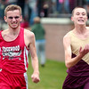 WARREN DILLAWAY / Star Beacon<br /> NOAH MORGAN (left) of Edgewood sprints to the finish with Chet Mientkiewicz of Pymatuning Valley Wednesday during the Ashtabula County Cross Country Meet at Lakeshore Park in Ashtabula Township.
