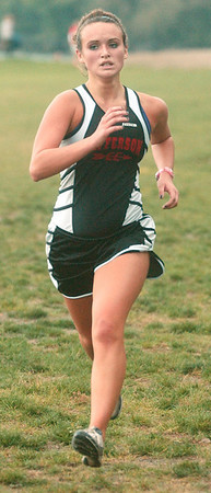 WARREN DILLAWAY / Star Beacon<br /> COLEEN O'CONNER of Jefferson (left) sprints to the finish line i during the Ashtabula County Cross Country Meet at Lakeshore park in Ashtabula Township.