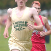 WARREN DILLAWAY / Star Beacon<br /> BRADY BUNNELL of Lakeside leads Deryn Tomsic of Edgewood Wednesday afternoon during the Ashtabula County Cross Country Meet at Lakeshore Park in Ashtabula Township.