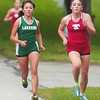 WARREN DILLAWAY / Star Beacon<br /> EMILY DEERING (right) of Geneva and Karen Barrientos of Lakeside battle it out during the Ashtabula County Cross Country Meet Wednesday afternoon at Lakeshore Park in Ashtabula Township.