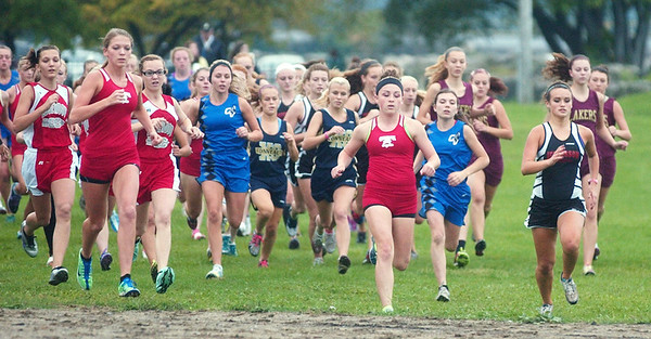 WARREN DILLAWAY / Star Beacon<br /> GIRLS SPRINT to the beach Wednesday afternoon during the Ashtabula County Cross Country meet at Lakeshore Park in Ashtabula Township.