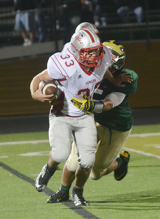 WARREN DILLAWAY / Star Beacon<br /> AARON ROSSI (with ball) of Geneva tries to break a Lakeside tackle on  Friday night at Lakeside.