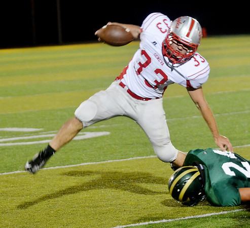 WARREN DILLAWAY / Star Beacon<br /> AARON ROSSI (30) of Geneva tries to break a tackle by Kyle Downs of Lakeside on Friday night at Lakeside.