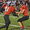WARREN DILLAWAY / Star Beacon<br /> LUCAS HITCHCOCK (right), Jefferson quarterback, hands to running back Hunter PPridemoore on Friday during a home game with Liberty.