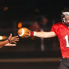 WARREN DILLAWAY / Star Beacon<br /> BRETT POWERS of Jefferson hands the ball to an official after scoring a touchdown Friday night during a home game with Newton Falls.