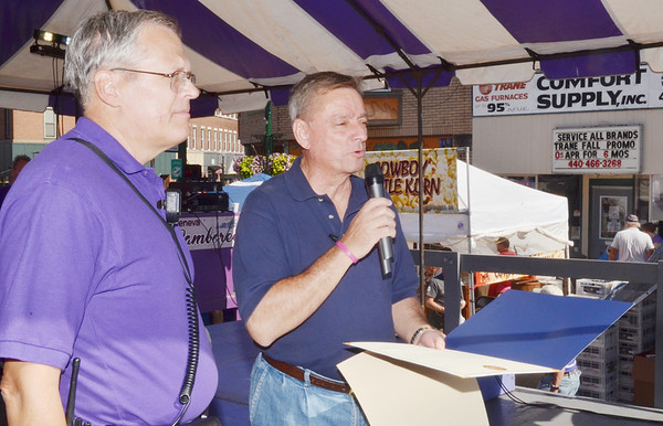 WARREN DILLAWAY / Star Beacon<br /> STATE SENATOR John Patterson (right) presents Dave Johnson, chairman of the Grape Jamboree committee, with a proclamation recognizing the festival's 50th anniversary.