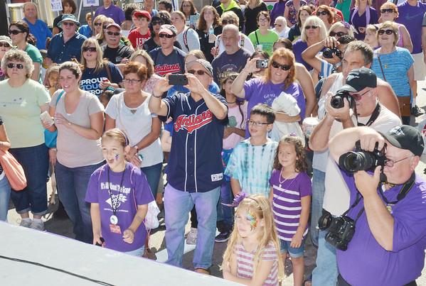 WARREN DILLAWAY / Star Beacon<br /> GRAPE STOMPING fans react to the contestants on Saturday at the Grape Jamboree in downtown Geneva.