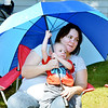 WARREN DILLAWAY / Star Beacon<br /> AMY WOOD holds her son Johnathan Wood, 16 months, during the Grape Jamboree parade on Saturday afternoon in Geneva....