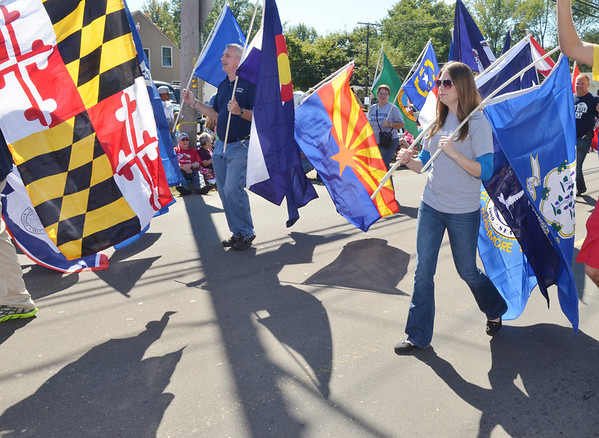 WARREN DILLAWAY / Star Beacon<br /> MOLLY SCHARPING (right) walks with a group from Grand River Academy carrying 50 flags for the 50 years of the Grape  Jamboree on Saturday in Geneva.