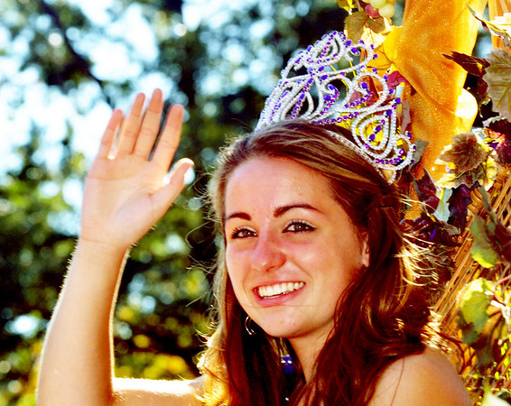 WARREN DILLAWAY / Star Beacon<br /> EMILY DEERING, Miss Grapette 2013, waves to the crowd on Saturday during the Grape Jamboree parde in downtown Geneva.