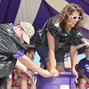 WARREN DILLAWAY / Star Beacon<br /> KIMY TYLIEKI of Lakewood participates in the grape stomping contest on Saturday at the Grape Jamboree in downtown Geneva as Mike Gonzalez keeps the bucket from tipping over.