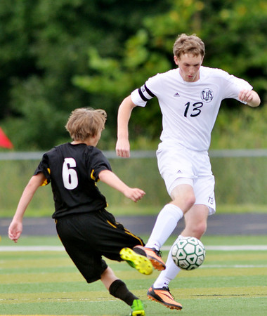 WARREN DILLAWAY / Star Beacon<br /> ANDREW STEEN (13) of Lakeside and Colton Priester of Riverside (6) fight for the ball during a soccer match at Lakeside on Tuesday.