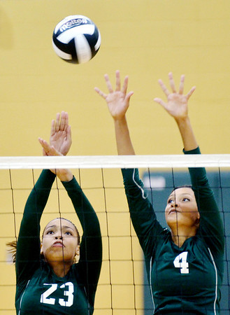 WARREN DILLAWAY / Star Beacon<br /> AALIYAH HUNT (4) and Sharisse Hunt (23), both of Lakeside, leap for a block of a spike by Alicia McGuire of Madison on Tuesday night at Lakeside.