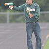 WARREN DILLAWAY / Star Beacon<br /> LAKESIDE ASSISTANT Soccer Coach Juan Aguinaga catches a water bottle during a home match with Riverside on Tuesday.