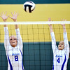 WARREN DILLAWAY / Star Beacon<br /> CAILA DENICOLA (8) and Gabby Ranson, both of Madison, leap for a block on Tuesday during a match at Lakeside.